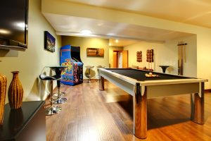 A finished basement with a game room